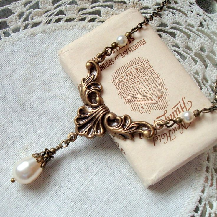 Teardrop Necklace , Swarovski Pearl , Downton Abbey Style, Neo Victorian Jewelry , Antiqued Brass Bronze, White or Cream. $26.50, via Etsy.