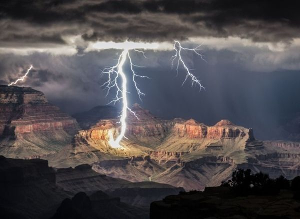 Photobucket user dbhawbaker shares this amazing photo of a lighting storm striking above a quiet canyon.
