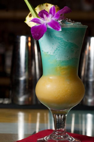 NYPD Blue: Santa Teresa Gran Reserva Aged Rum, Pineapple Juice, Coconut, Lime, Mango, and Demerara with Orchid, Pineapple, Pineapple Leaf, and Coconut Garnish