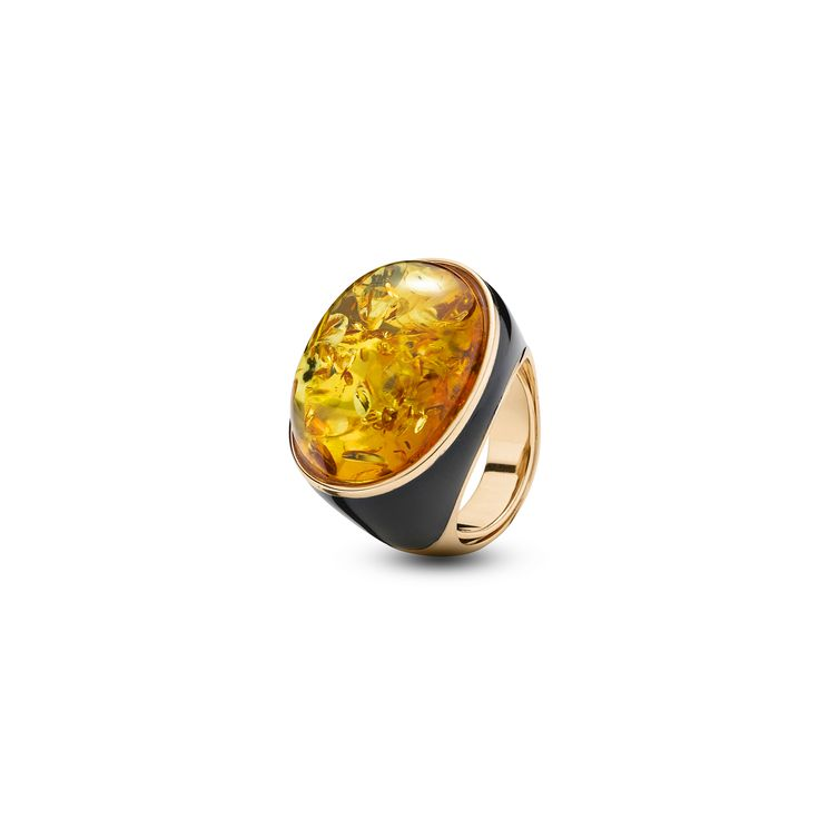 House of Amber - Desirable ring in rose gold sterling silver, black enamel, and cognac amber. The ring has a magnetizing design and is a part of the Enlightened Enamel Collection.