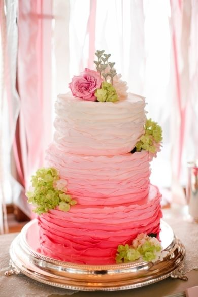 Add a hot pop of colour with a pink ombre wedding cake. Image: Katelyn James via Southern Weddings