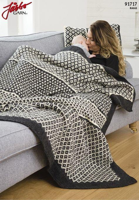 Smuk plaid i flot grafisk mønster. Det flotte tæppe er dejlig varmt og er perfekt til de kolde årstider.