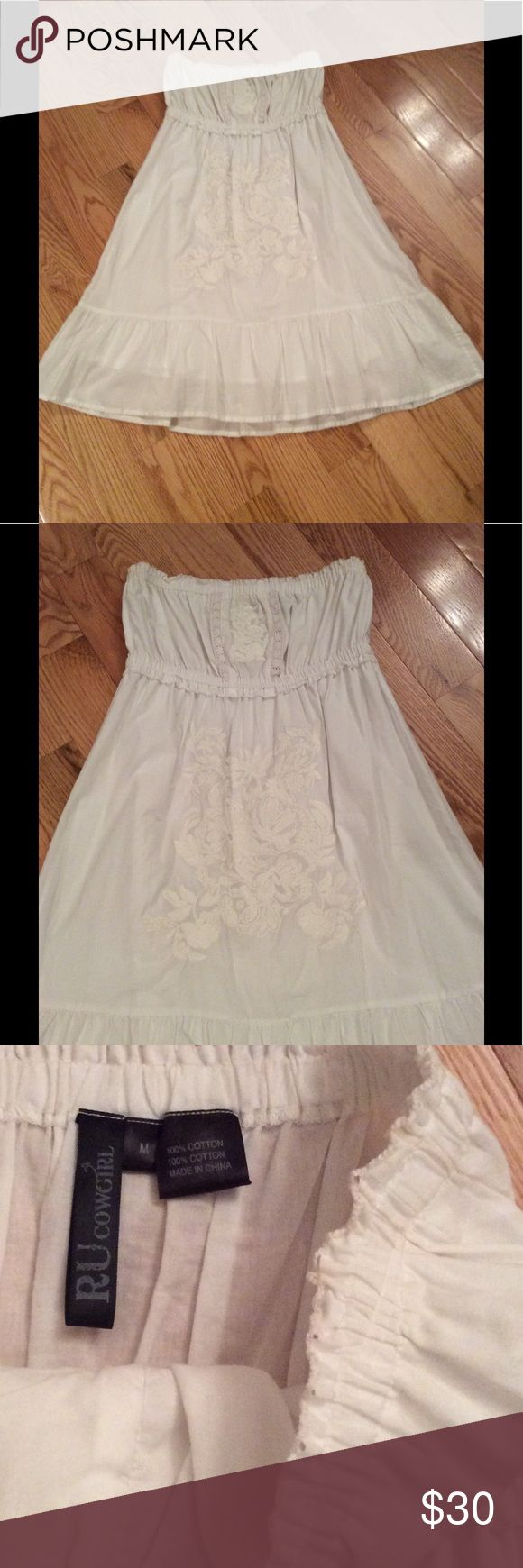 Strapless white lace sundress Strapless white lace sundress. This sundress is adorable. I wish it still fit me. It has elastic at the top with lace detail on front. It is NOT see through. I bought this dress in Nashville TN at a western store and wore it once with cute Brown western boots. This is a short dress. See measurements. It says size med but fits like S/XS make me an offer' Dresses Strapless