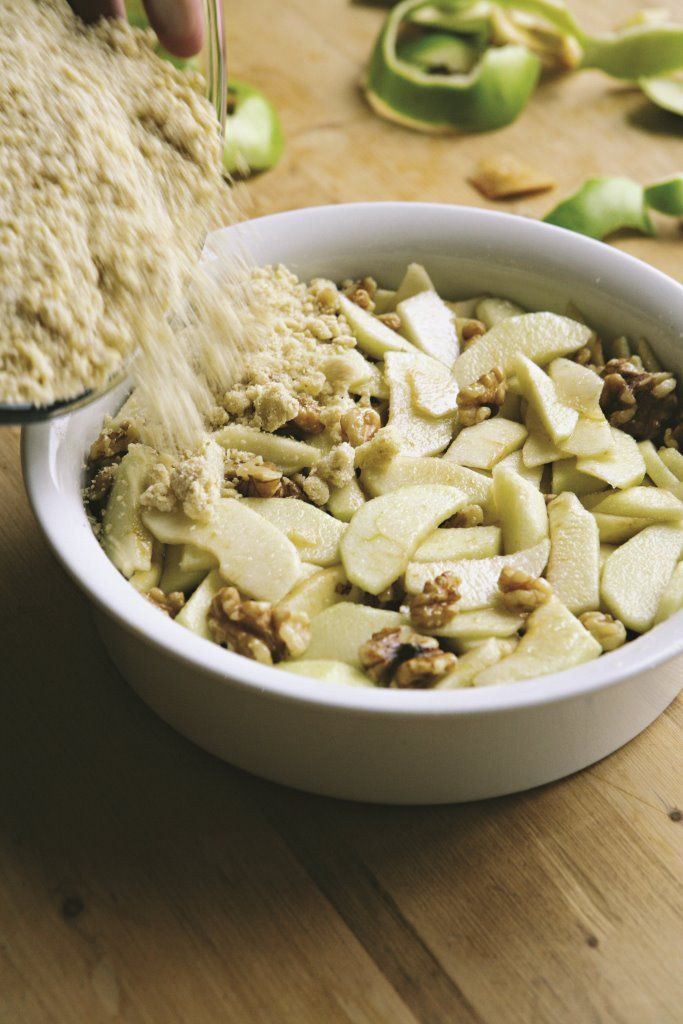 The nubbly crunch of toasted walnuts adds a new dimension to a classic crumble; pecans are equally good. This basic crumble topping can be used on all sorts of other fruits, from winter rhubarb, through to summer gooseberries or plums, to autumnal blackberries, pears or quince.