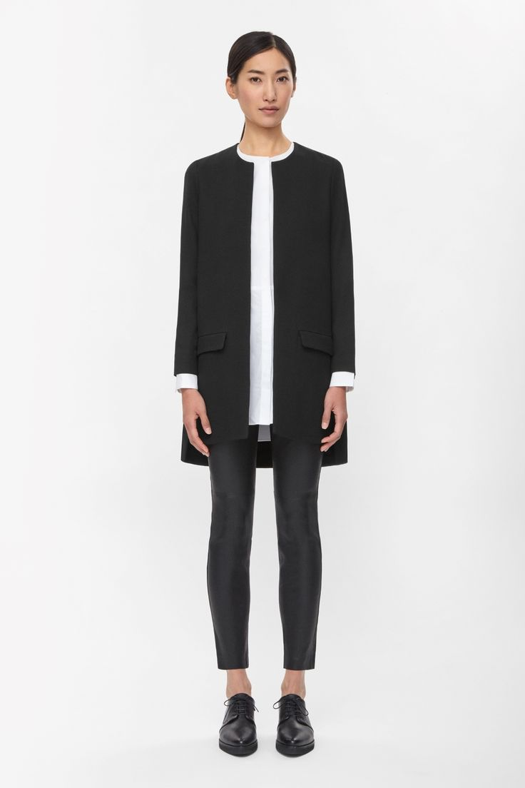 A clean, minimal style, this long blazer has a round neckline and simple front flap pockets. Subtly A-line, it has a graduated hemline, silky lining and an easy open front. Wear it as a blazer or a lightweight jacket.
