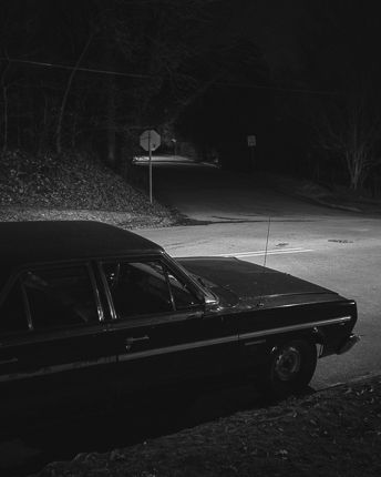 Adam Bellefeuil ------ lone car again. this time uncovered. darkness still retains sense of mystery.