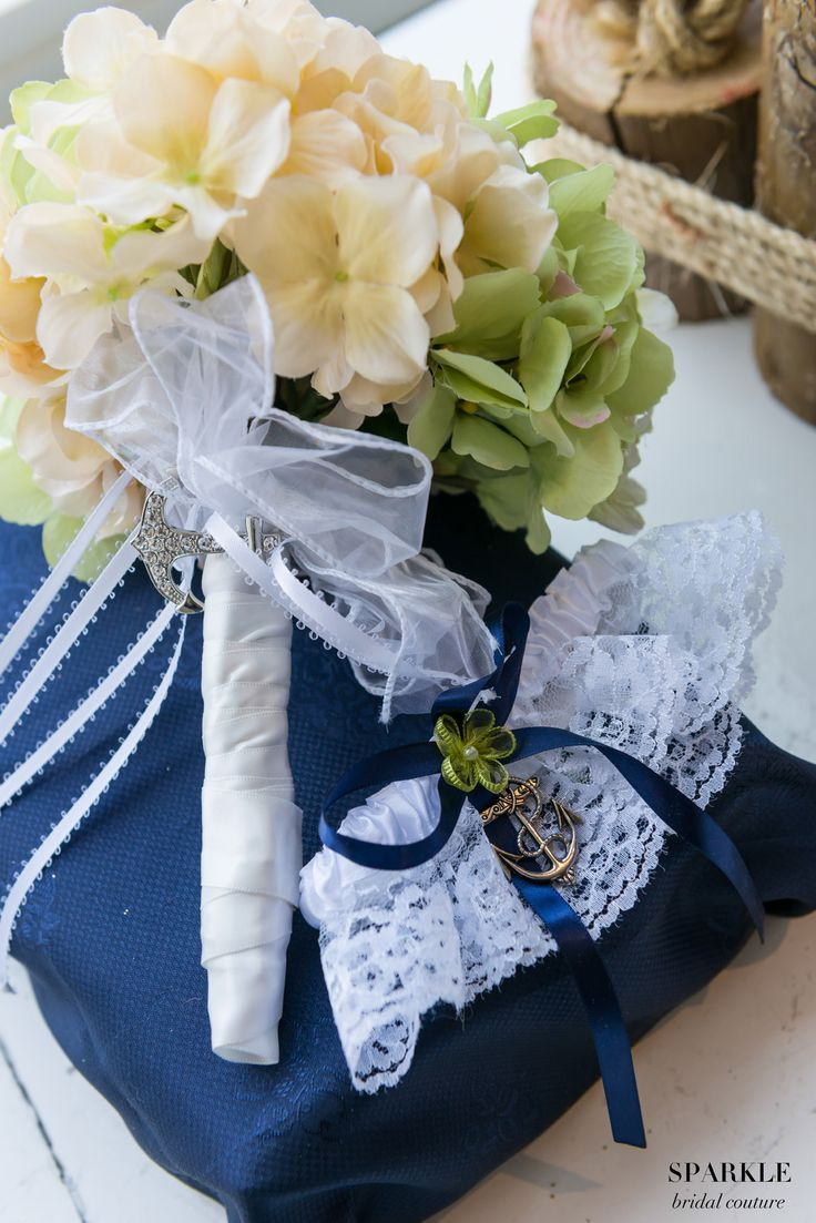 Keep the nautical theme throughout the entire wedding by adding little anchor charms to your garter and bouquet!  #Nauticalwedding #Anchors #Bouquet #Garter