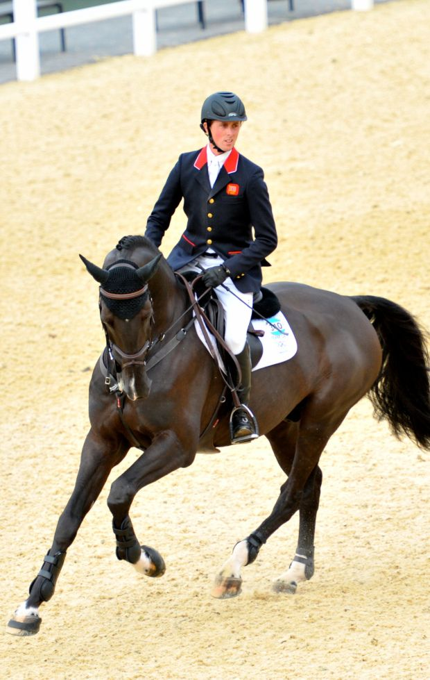 Olympic champion Ben Maher has been crowned the leading riding at the London International Horse Show, 2012. Britain's very own Ben, 29, won four classes on four horses during the competition at Olympia. Pictured here on Tripple XXX.