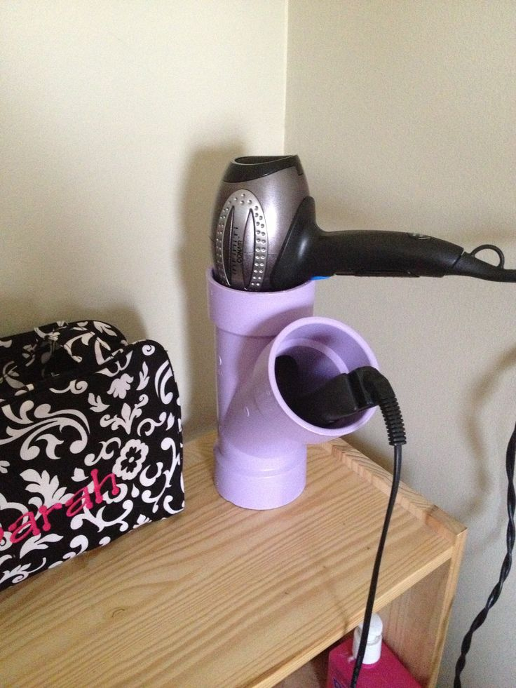 "Hair dryer & straighter holder. 3"" Y pvc from Home Depot and purple spray paint."