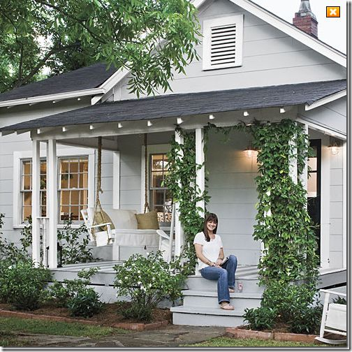 I love this front porch. I love the porch swing. I wonder if there is anyway to build something like this on the front of my very boring ranch style home.