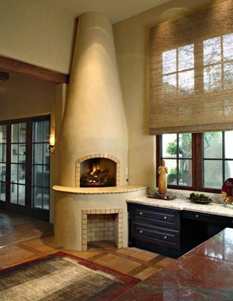 Janet Brooks Design | Scottsdale, AZ | Luxury Interior Design  A kiva inspired corner fireplace covered in stucco  with white brick accents
