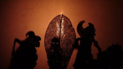 "In the middle of the screen, note the leaf-shaped ""tree of life"" or Kayonan. It is one of the most important puppets in Wayang Kulit, the Javanese art of shadow puppetry."