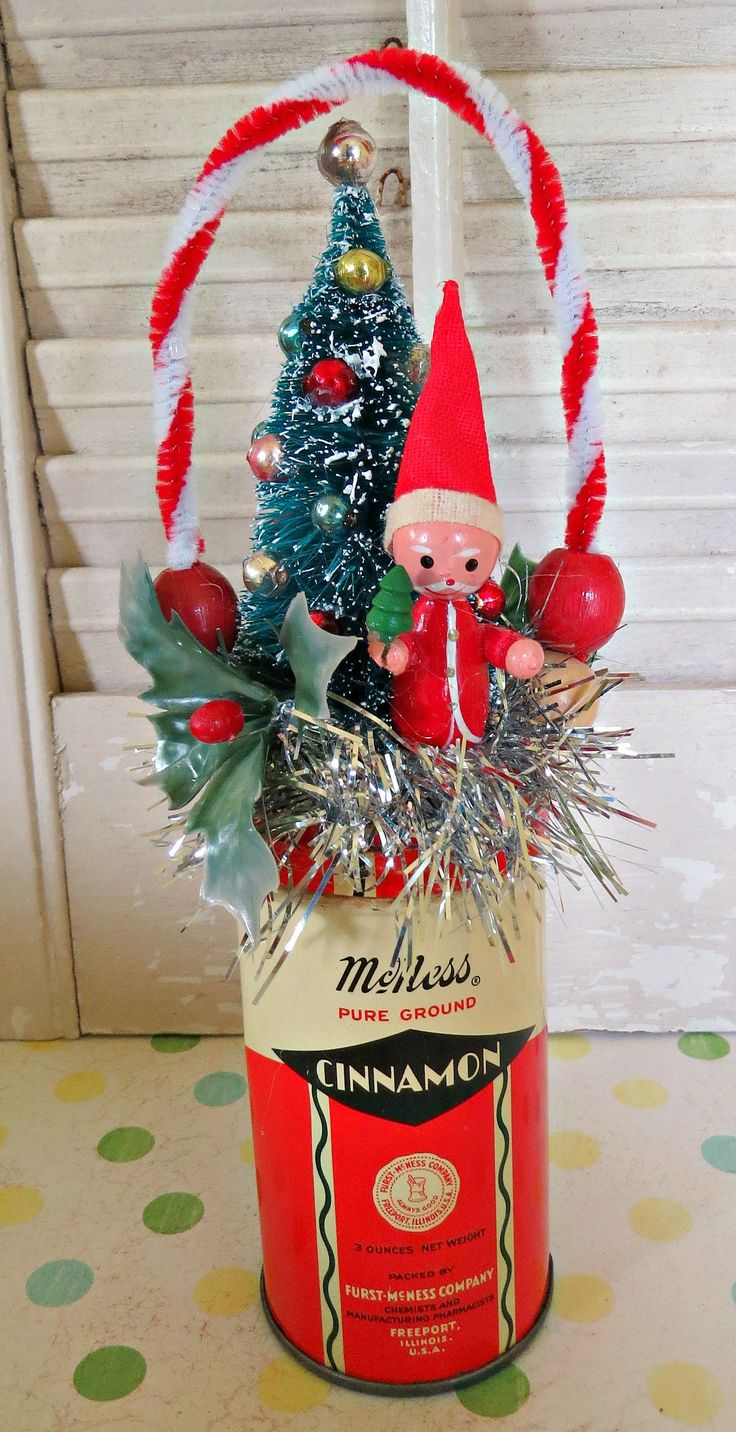 Holiday FUN!Here is a fun Christmas decoration made with vintage and new materials!This whimsical decoration features a vintage spice tin with a chenille handle, vintage wooden Santa, bottl...