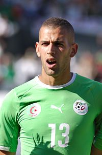 Islam Slimani (born 18 June 1988) is an Algerian footballer who plays as a striker for Portuguese Primeira Liga side Sporting Clube de Portugal and the Algeria national team.  An Algerian international, Slimani made his international debut in 2012. As of June 2014, has won 20 international caps and scored 11 goals.