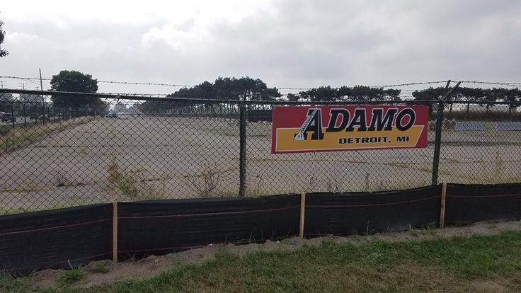 Fence sign installed at a job site for adamogroup