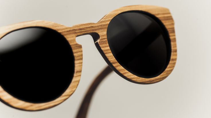 A pair of Kiara in Zingana.    Rezin Wooden Sunglasses. www.rezin-wood.com