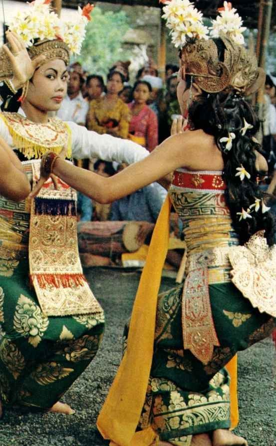 Women dancing a reinactment of a Balinese legend in a village near Bali's capitol    National Geographic | March 1980: