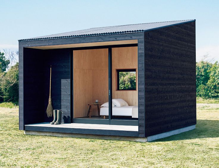 Japanese minimalist brand MUJI has for years focused on simple, well-designed apparel, home goods, & lifestyle products. Now they're going outside the box with their highly anticipated $27K tiny homes. Their minimalist 100-square foot pre-fab tiny cabin features a glass wall slider entry for maximum natural light, a small woodstove, and an exterior finish of shou sugi ban—charred timber. Availability begins in Japan.