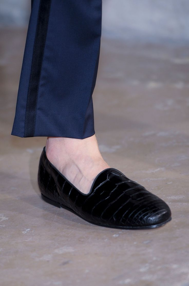 Hermes. Cool shoes, he should really be wearing socks though.