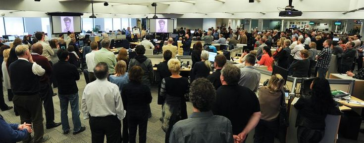 The newsroom gathered for the afternoon memorial. (Richard Lautens/Toronto Star)