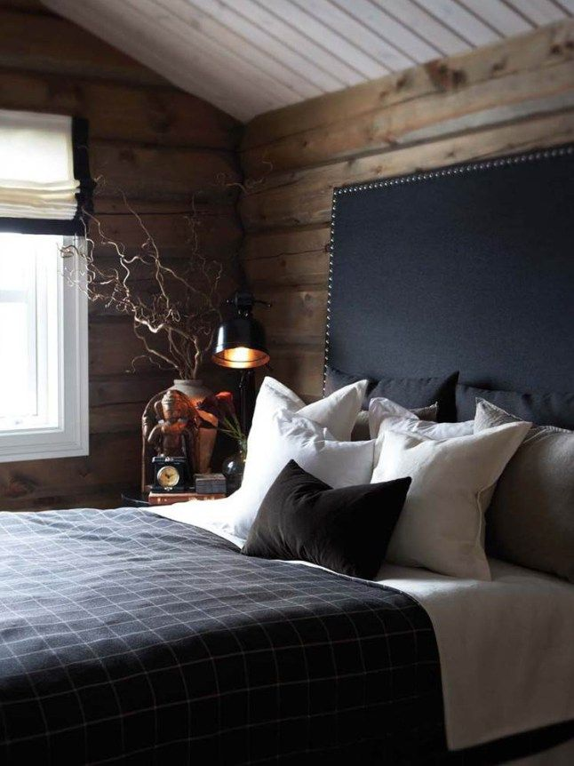 Rustic- wood panelled walls, black headboard, cosy bedding, masculine design