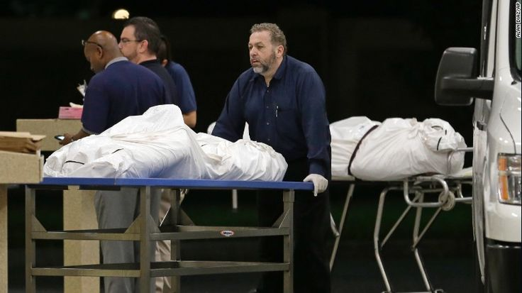 Bodies arrive at the medical examiner's office on June 12.