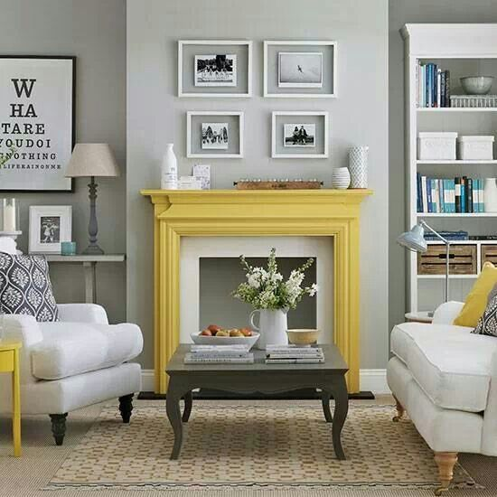 Great wall art display above the mantle. Stunning colour scheme, neutral grey and whites with a splash of yellow