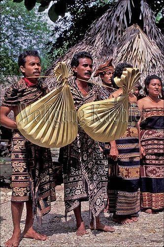 Indonesia, sawu (Seba) Island native dancers with string instruments, sasando (Ketadu haba)