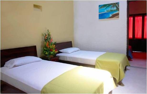 habitación múltiple hotel Sansiraka en Santa Marta