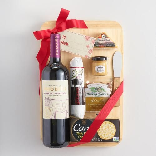 This holiday gift basket has everything we would love to get as a gift! Each one features a wine exclusive to World Market paired with our gourmet salamis, cheeses, olives and crackers. We're also giving you a cutting board to transform it into a terrific on-the-go picnic.