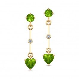 A minimalist pair of drops that start with a round peridot, leading down to a bezel-set diamond, and culminating in a lovely heart-shaped peridot.