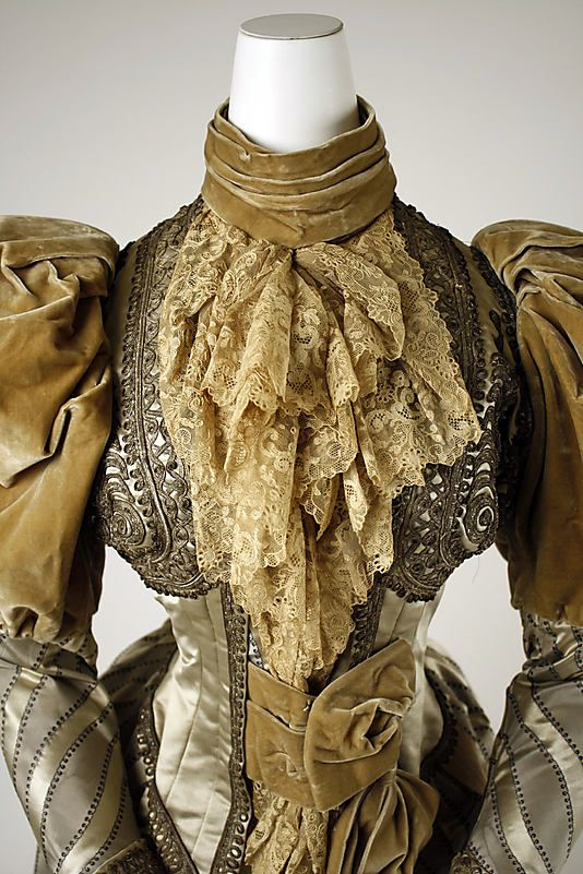 Bodice detail.  With the exception of the sleeves, the style is a bit earlier than the 1894 date.  Wonder if it was remade/updated from a late 1880s gown?