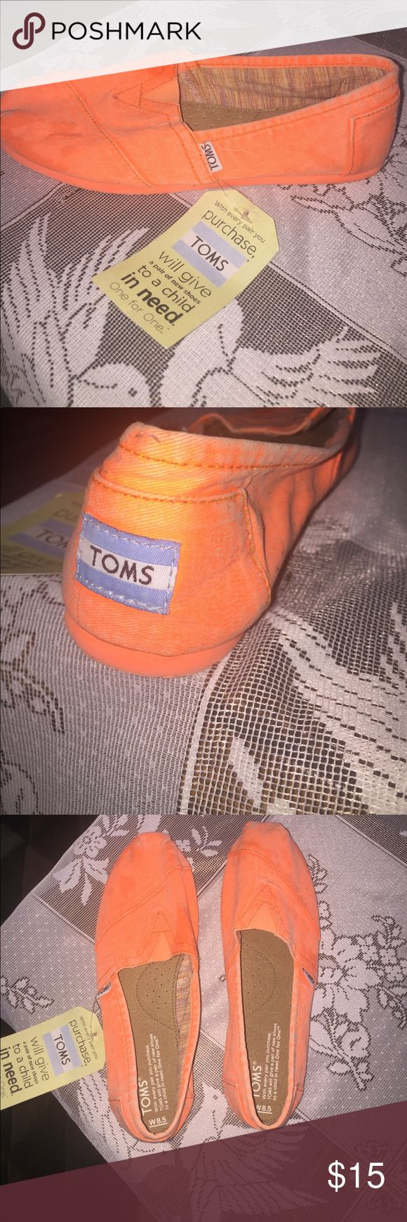 Brand new Toms sneakers Brand new bright orange Toms sneakers never worn still with tags. They have been sitting on the bottom of my closet so a few dirty marks, just need to be washed. Toms Shoes Sneakers