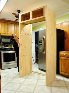 Use Young House Love's fridge plan with the Ana White Laundry stand to build in the washer and dryer. I love DIY bloggers :)