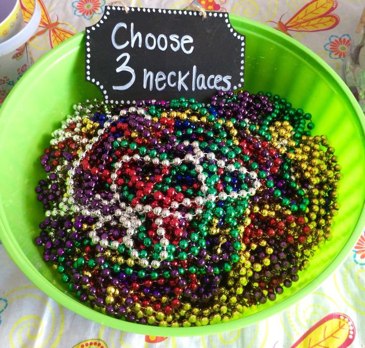 Bridal shower game: Each guest picks three necklaces & can't say Bride, Wedding or Married! If they hear someone say one of those words they can steal one of their necklaces. The person with the most beads at the end wins a prize! (Beads come in sets of 8 @ the Dollar Tree, got the bowl there as well, and the cute chalkboard sign is from the dollar section at Target!)