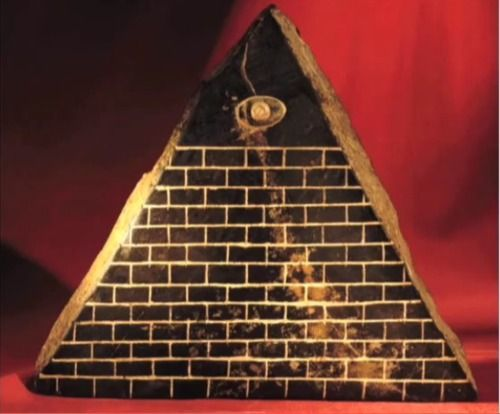 "An artifact found in Ecuador (1980s), the so-called Pyramid with the Eye. It has 13 steps,the eye is an inlay, looks exactly like the Pyramid on the US $1 bill. On the bottom, there's an inlay in little gold plates showing the Orion star constellation, and a writing which translate; ""The son of the creator comes""."
