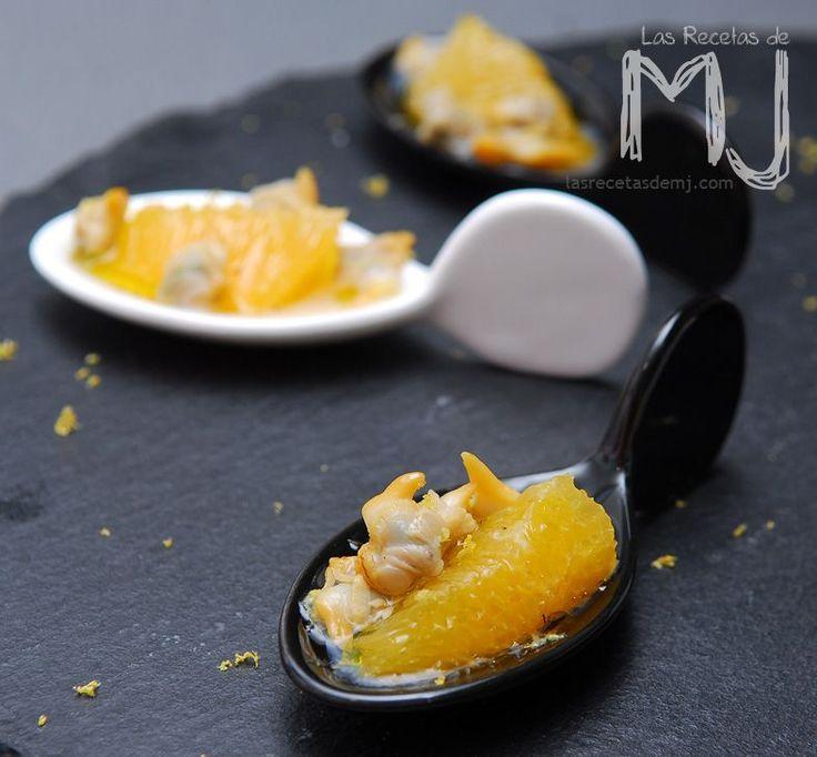 INGREDIENTES: 4 personas     1 lata de berberechos en conserva  1 naranja  Zumo de 1/2 limón  Un chorrito de aceite de oliva  Pimienta   PR...