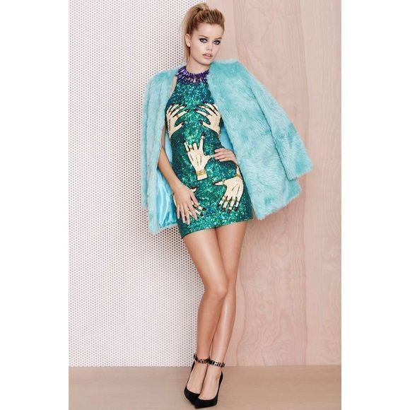 """S A L ENast Gal Candy Flip Faux Fur Coat """"This turquoise faux fur coat is the perfect way to break up your all-black-everything vibe this winter. It has snap button closures at front, a crew neck, and full lining. Wear it with a long black slip dress and boots."""" Nasty Gal Jackets & Coats Trench Coats"""