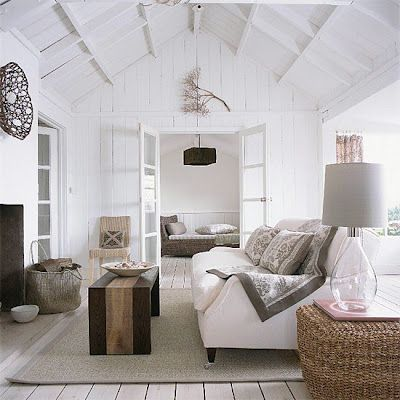 Great eye catching pendant in the far room and neutral lamp in the foreground...all white is clean and classic.