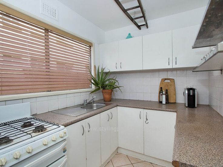 A bit of a declutter and tidy up and this kitchen came up surprising well in this 2 bedroom beachside unit