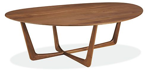 Clean lines combined with an organic form lend a softly modern, timeless feel to the Dunn cocktail table. Created by skilled Vermont artisans, Dunn features unique joinery that gives the base the illusion of being carved from a single piece of wood, and is stunning in either walnut or cherry.