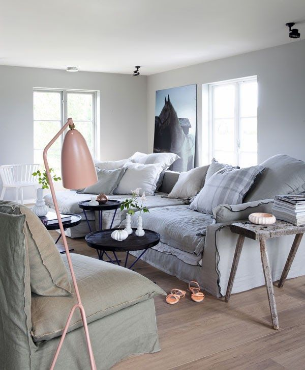 feeling Norwegian today ... soft tones and huge sofa...Metro tiles and grey kitchen... a beautiful square table with an old bench... love e...