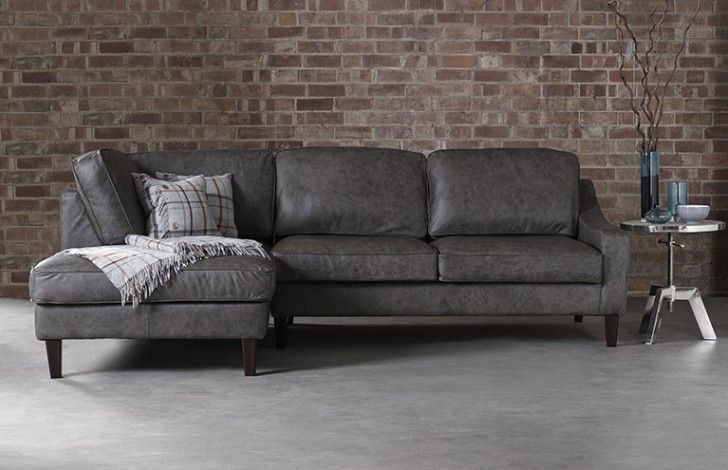 The Hilary grey leather 3 seater x chaise chaise is a unique piece of furniture with its sweeping arms and tall feet it would look ideal within a contemporary setting as well as fitting in amongst vintage décor. The foam and fibre cushions make this grey leather chaise a perfect place to sit back and relax.