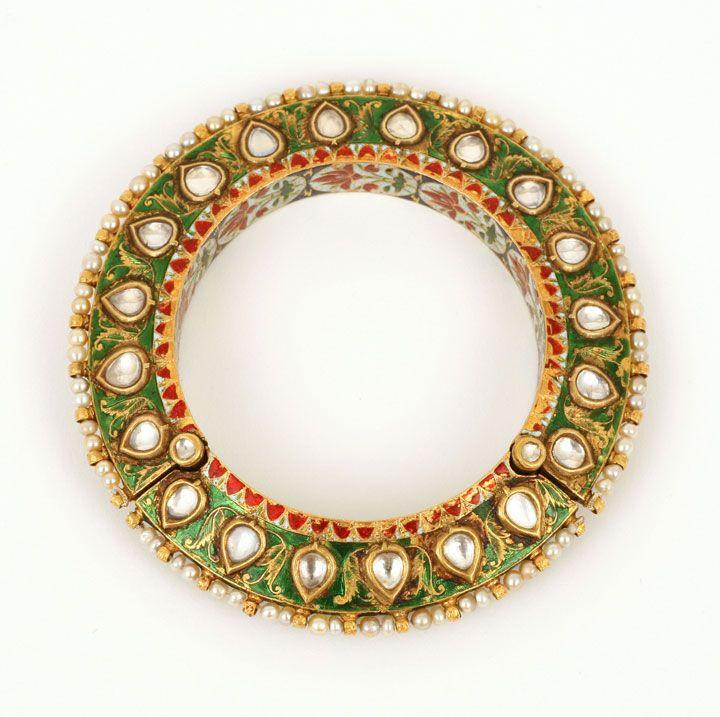 Hyderabad, Deccan, 18th Century. A gold bracelet set in the kundan style with flat cut diamonds.