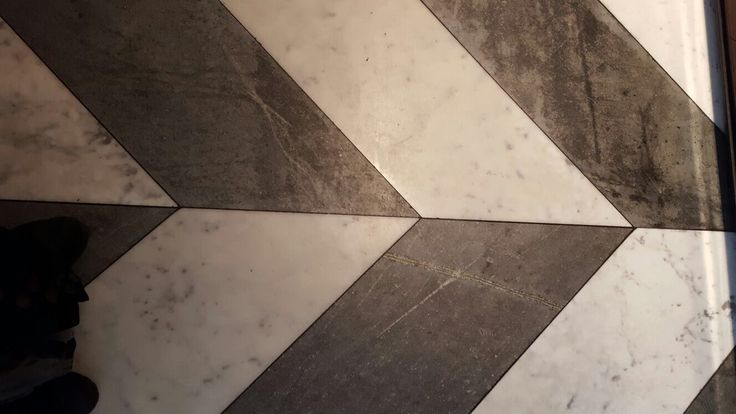 pin 2: In crown Casino on the floor they used beautiful black and white tiles that's looks like marble .