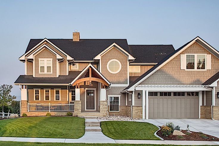 The Garage Bay Of This Craftsman Home Is Planned With The