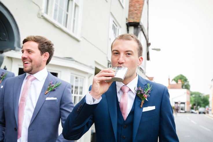 Dutch courage - The Groom and ushers in blue suits and dusky pink ties with wild flower button holes wrapped in copper