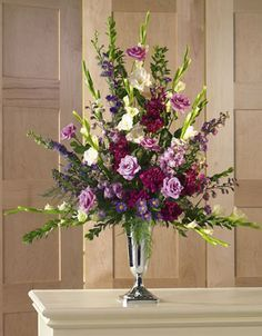 Church Wedding Flower Decorations - Altar Spray in Silver Goblet - White Gladiolus, lavender roses, Aster, Italian Ruscus and burgundy carnations.