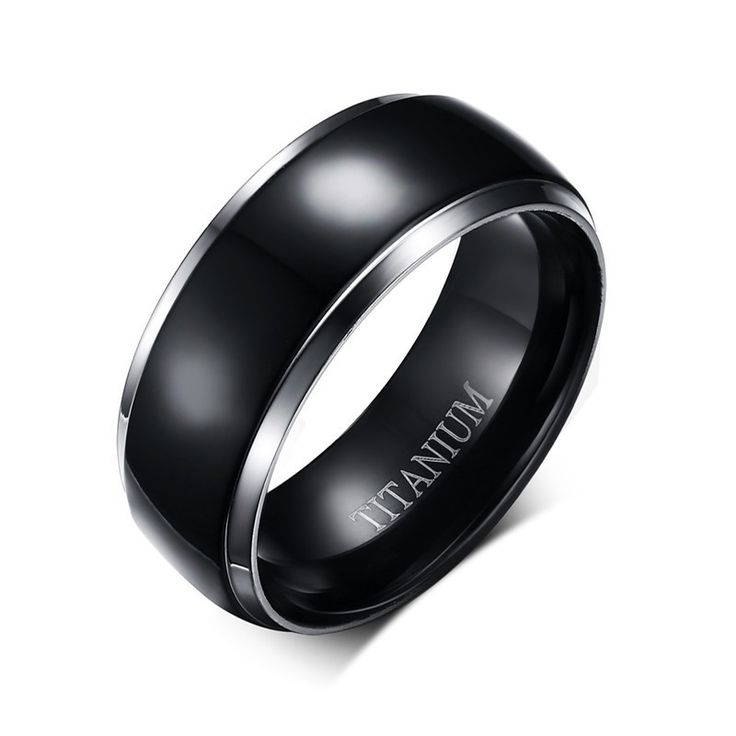 The newest trend in men's jewelry is the ultra tough but oh so sexy, black titanium. Our magnificent black dome band is crafted of the finest titanium metal and inlaid with a wide band of anodized tit