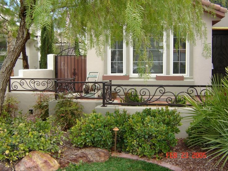 Enchanting Rod Iron Fence With Chic Ornament For Outdoor Design: Cool Backyard With Rod Iron Fence And Stucco Also Window Treatments With Landscaping Ideas